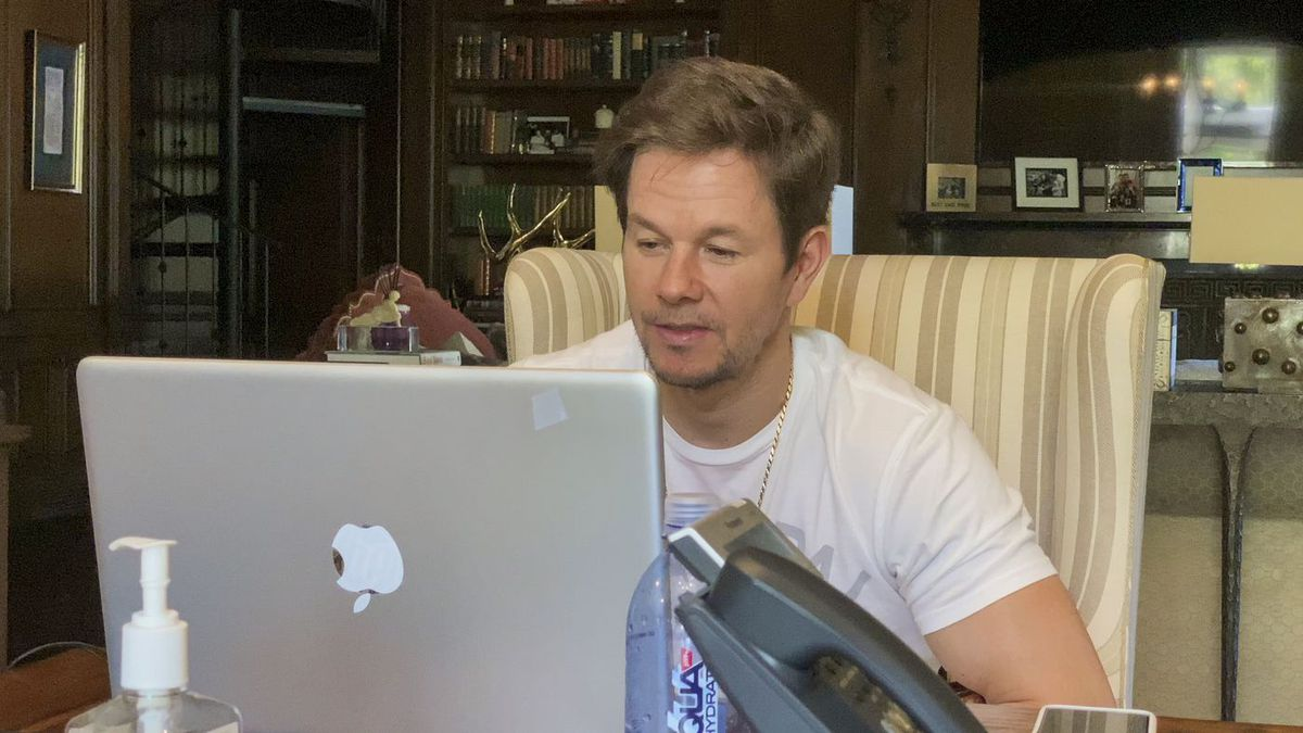 Mark Wahlberg sits in front of his Mac in his home office.
