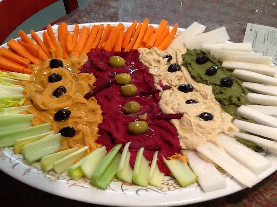 A closeup of a rainbow hummus plate with various vegetables at Cafe Turko.