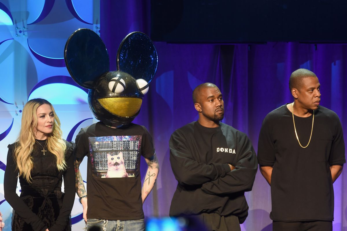 Madonna, Deadmau5, Kanye West, and Jay Z stand on stage at the Tidal press conference.