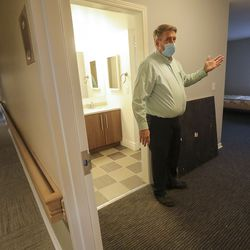 Tim Stay, CEO of The Other Side Academy, shows a remodeled room in a former senior living center next door that academy is using to expand its operations in Salt Lake City on Thursday, Dec. 17, 2020. The academy is a 2 1/2-year residential program where those who have been involved in the criminal justice system can learn social, vocational and life skills. A $100,000 donation from businessmen David Ibarra and K.O. Murdock is making the expansion possible.