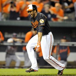 Baltimore Orioles designated hitter Chris Dickerson (36) reacts after hitting the game winning walk-off three-run home run in the ninth inning against the   Detroit Tigers.