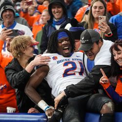 Boise State safety Tyreque Jones celebrates the victory against BYU with fans at LaVell Edwards Stadium in Provo on Saturday, Oct. 9, 2021.