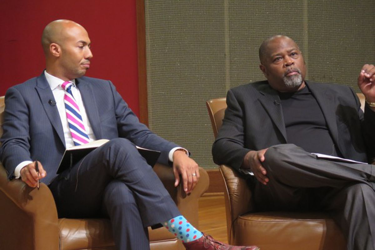 Ahmed Young (left), education director for the city of Indianapolis and Indiana University law professor Kevin Brown were among five panelists who discussed school integration in Indianapolis at an event co-sponsored by Chalkbeat.
