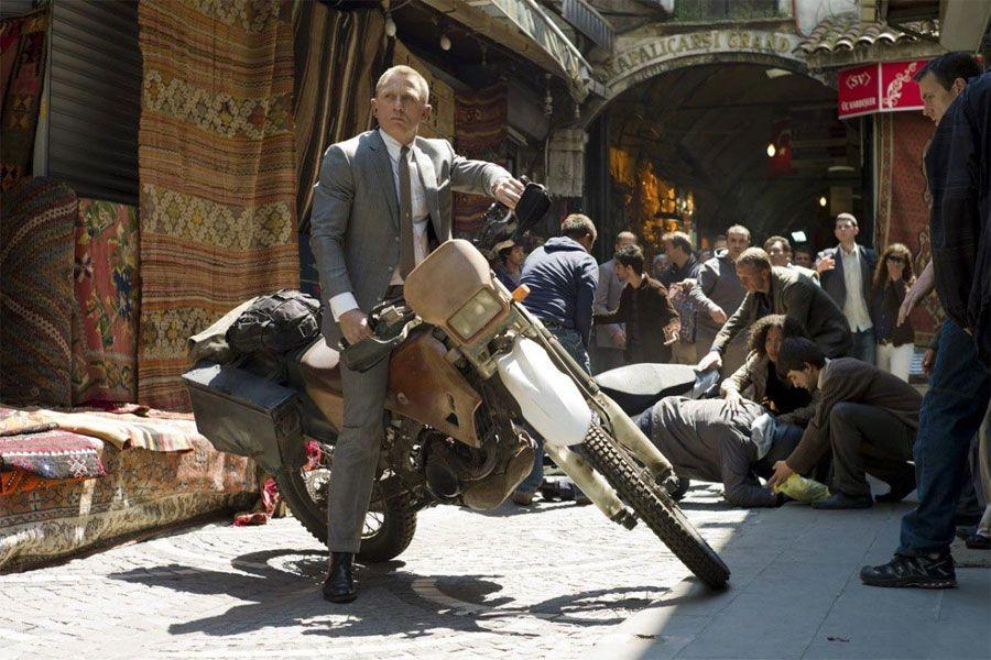 Daniel Craig as James Bond (007) on a motorbike in Skyfall