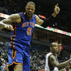 New York Knicks' Tyson Chandler (6) reacts after his dunk against Milwaukee Bucks' Monta Ellis, right, during the first half of an NBA basketball game on Wednesday, April 11, 2012, in Milwaukee.