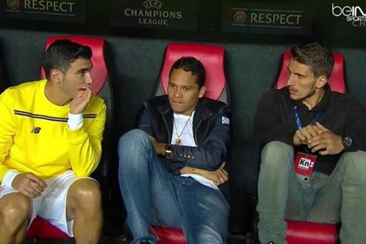 Milan's forwards Carlos Bacca sitting on Sevilla's bench before Tuesday night's match against Juventus.