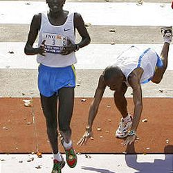 Winner Paul Tergat, of Kenya, crosses the line one-third of a second faster than South Africa's Hendrick Ramaala, the defending champion.