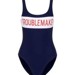 """Zoe Karssen's """"Troublemaker"""" slogan adds cheeky personality to an otherwise understated suit."""