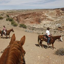 Riding along the ridge above Salt Wash while riding horses in the Sid's Mountain Wilderness Study Area of the San Rafael Swell  Friday, April 1, 2011, in the San Rafael Swell in Central Utah.