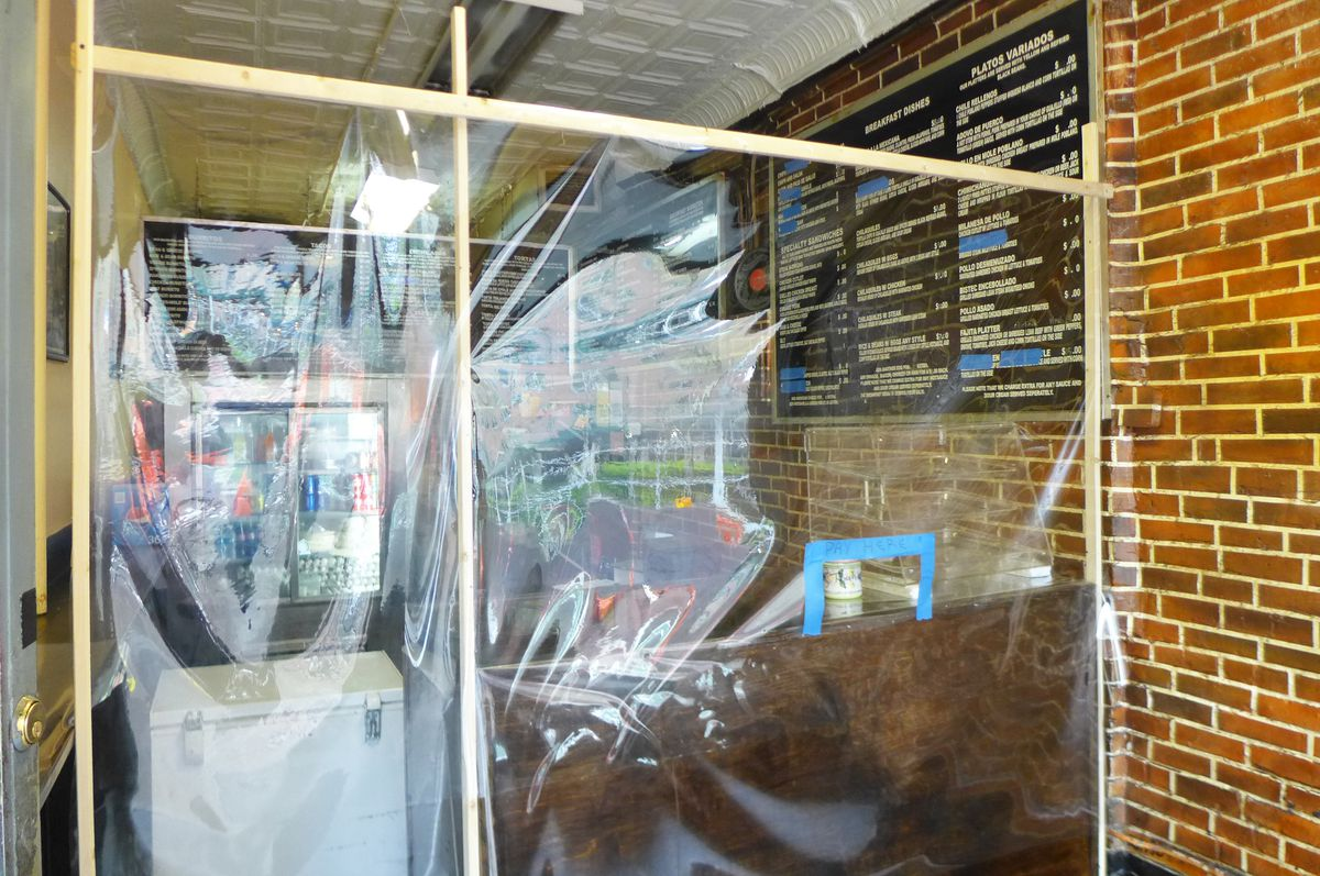 A sheet of plastic hangs across the width of the store a few feet inside the front door.