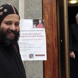 A Coptic and a catholic priest, right, walk outside the Augustinianum institute where an international congress on Coptic studies is held in Rome, Wednesday, Sept. 19, 2012. Scholars are questioning the authenticity and significance of a much-publicized discovery by a Harvard scholar who reported that a 4th Century fragment of papyrus has provided the first evidence that some early Christians believed Jesus was married. Karen King, a professor at Harvard Divinity School, announced the finding Tuesday at an international congress on Coptic studies in Rome.