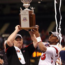 Kyle Whittingham and Utah quarterback Brian Johnson lift the trophy after beating Alabama in the Sugar Bowl Jan. 2.