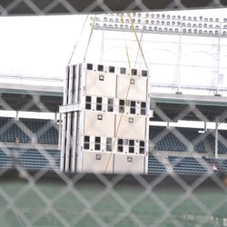 Video board components being lifted in left field -