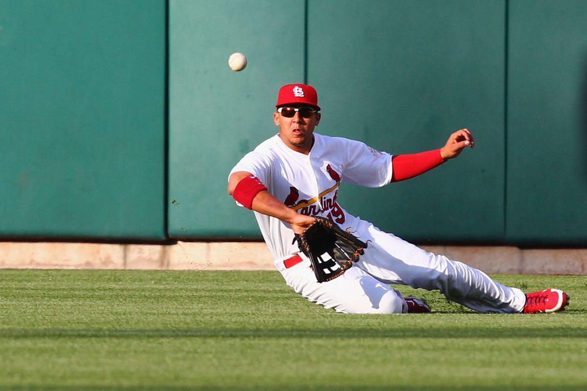 ST. LOUIS, MO - MAY 14: Jon Jay #19 of the St. Louis Cardinals attempts to catch a deep fly ball against the Chicago Cubs at Busch Stadium on May 14, 2012 in St. Louis, Missouri.  (Photo by Dilip Vishwanat/Getty Images)