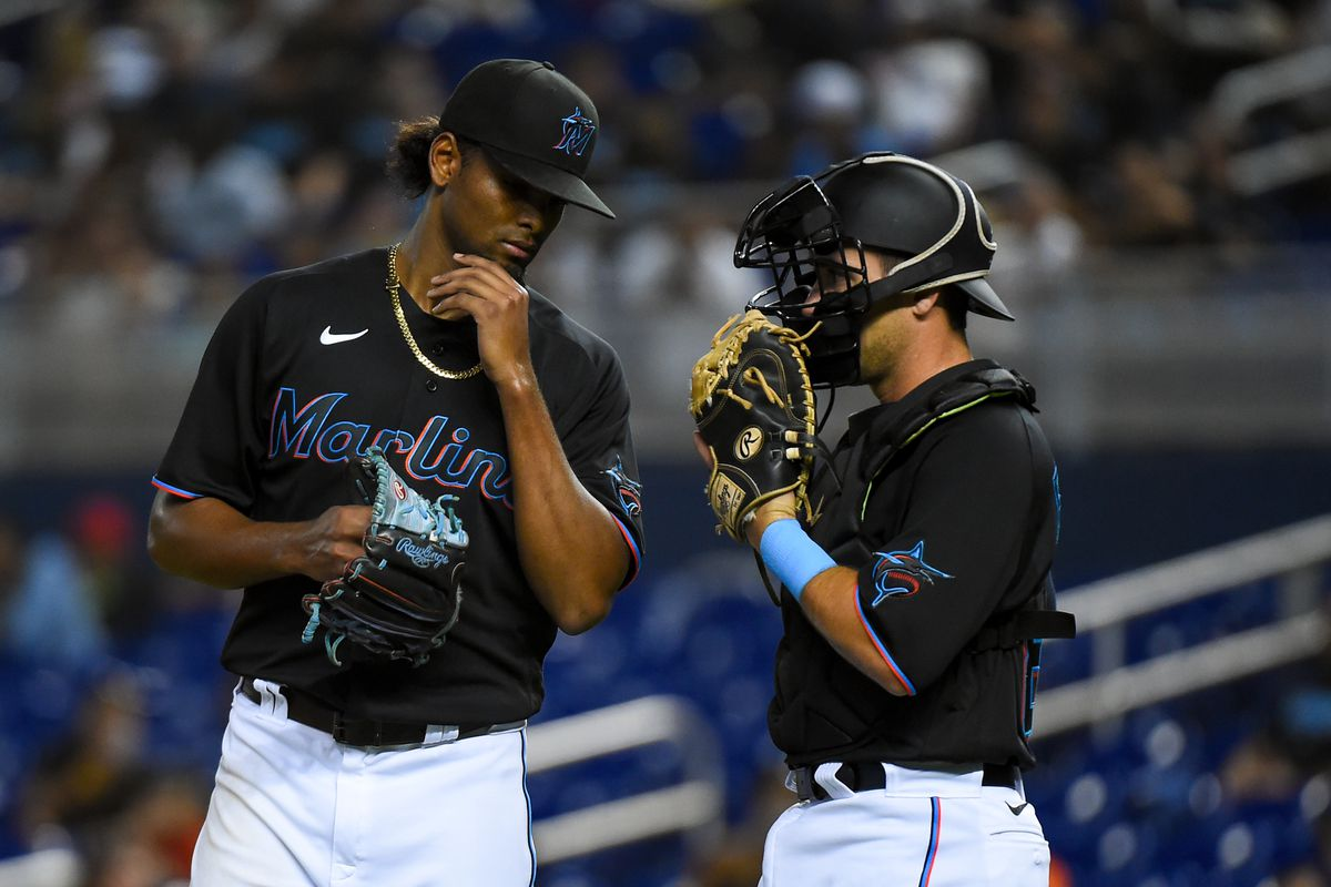 Edward Cabrera #79 of the Miami Marlins talks with catcher Nick Fortes #84 during the second inning against the Pittsburgh Pirates at loanDepot park