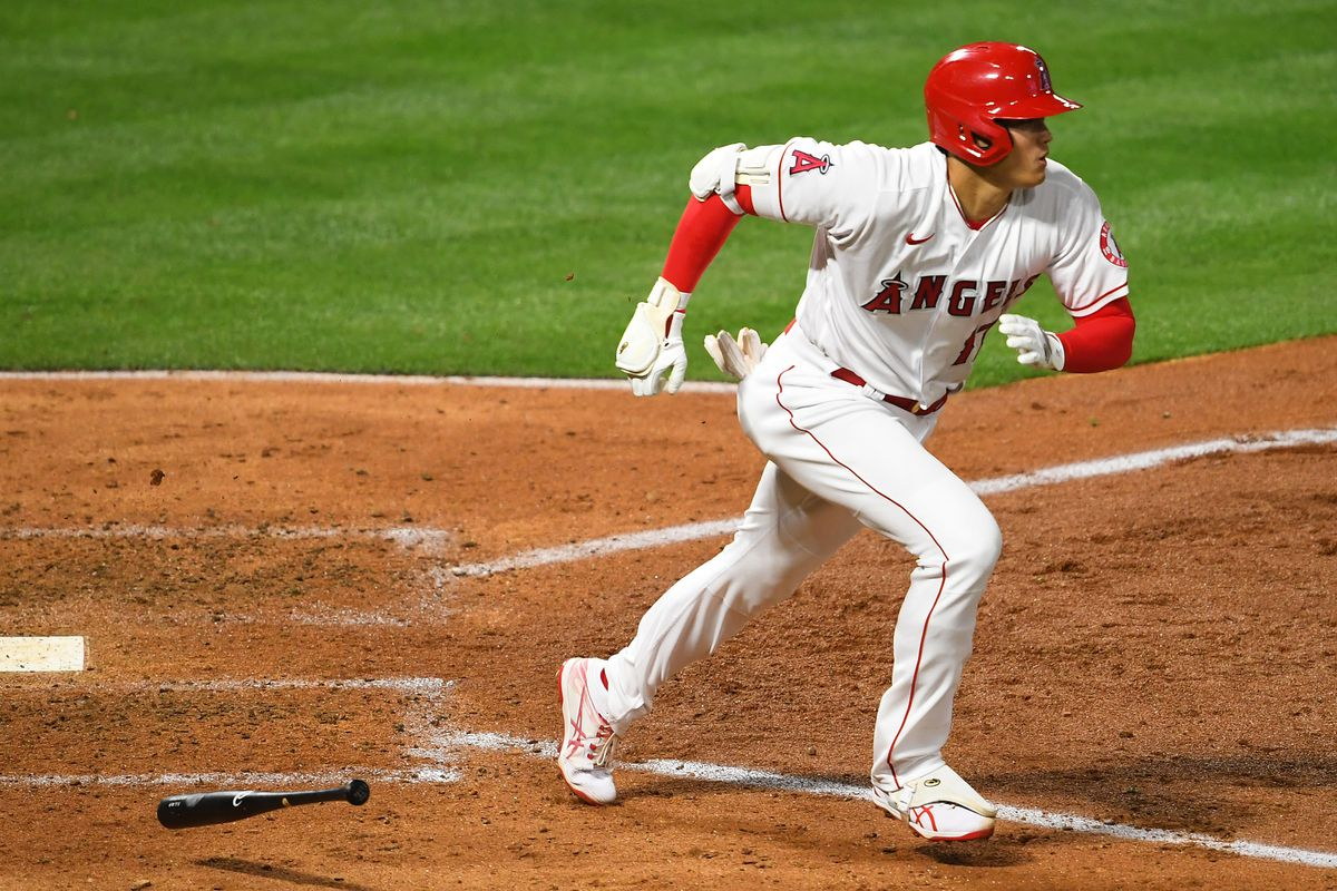 Los Angeles Angels designated hitter Shohei Ohtani runs to first base after hitting a single against the Chicago White Sox in the fifth Inning at Angel Stadium.