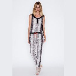 """<strong>Second Female</strong> Snake Print Drawstring Jumpsuit, <a href=""""https://shopacrimony.com/products/second-female-snake-print-drawstring-jumpsuit"""">$120</a> at Acrimony"""