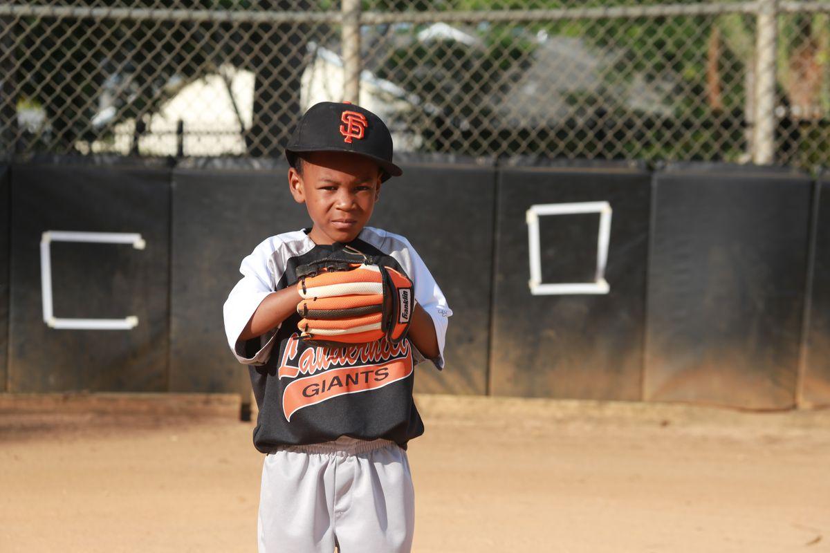 Black kid baseball player
