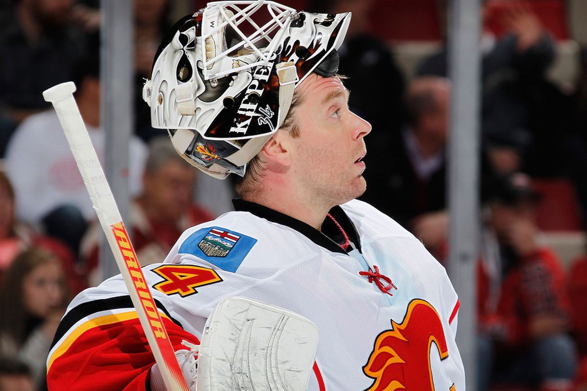 DETROIT, MI - NOVEMBER 03:  Miikka Kiprusoff #34 of the Calgary Flames looks on while playing the Detroit Red Wings at Joe Louis Arena on November 3, 2011 in Detroit, Michigan. Calgary won the game 4-1. (Photo by Gregory Shamus/Getty Images)
