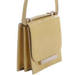 "<b>The Row</b> Lizard Small Classic Shoulder Bag, <a href=""http://www.barneys.com/The-Row-Lizard-Small-Classic-Shoulder-Bag/00505015020420,default,pd.html?cgid=women&index=37"">$4,800</a> at Barney's"
