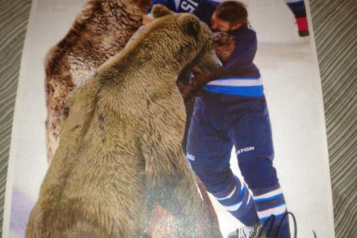 """A one-of-a-kind signed print of Fanner Glass fighting bears. Classic! Congrats <a href=""""https://twitter.com/#!/MitchMurr/status/179387427004219392/photo/1"""">Mitch Murray</a>, you're going to be a rich man one day!"""