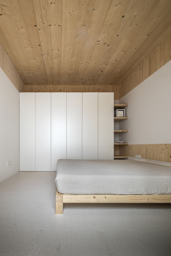 Bed in minimally designed bedroom.