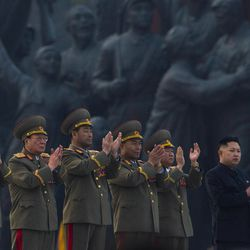 North Korean leader Kim Jong Un, far right, applauds with senior military officials at an unveiling ceremony for statues of the late leaders Kim Il Sung and Kim Jong Il in Pyongyang, North Korea, Friday, April 13, 2012.