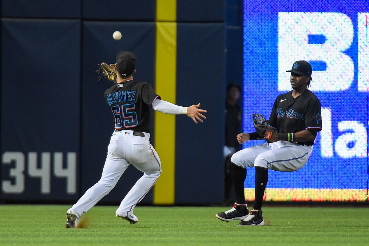 Eddy Alvarez #65 of the Miami Marlins attempts to catch a ball in the ninth inning against the Pittsburgh Pirates at loanDepot park