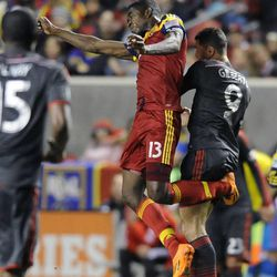 Real Salt Lake forward Olmes Garcia (13) heads the ball in front of Toronto FC forward Gilberto Oliveira Souza Junior (9) during a game at Rio Tinto Stadium in Sandy on Saturday, March 29, 2014.