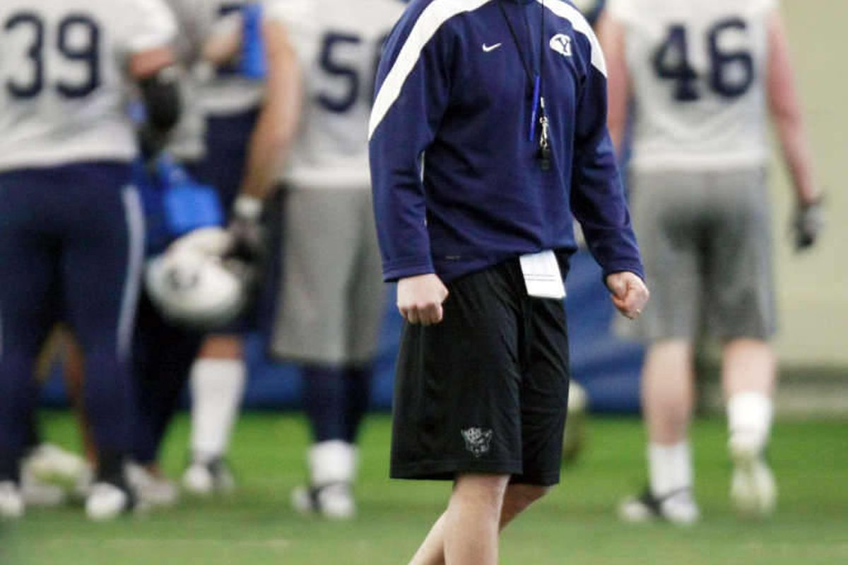 Head coach Bronco Mendenhall watches his players as BYU football players work out Monday, March 19, 2012 in the indoor practice facility during spring practices.