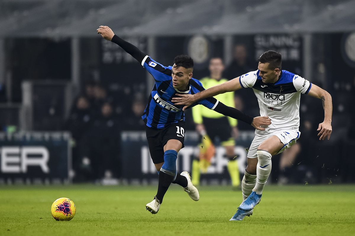 Lautaro Martinez (L) of FC Internazionale is challenged by...