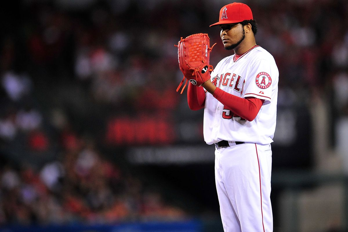 August 10, 2012; Anaheim, CA, USA; Los Angeles Angels starting pitcher Ervin Santana (54) waits for signals in the sixth inning against the Seattle Mariners at Angel Stadium. Mandatory Credit: Gary A. Vasquez-US PRESSWIRE