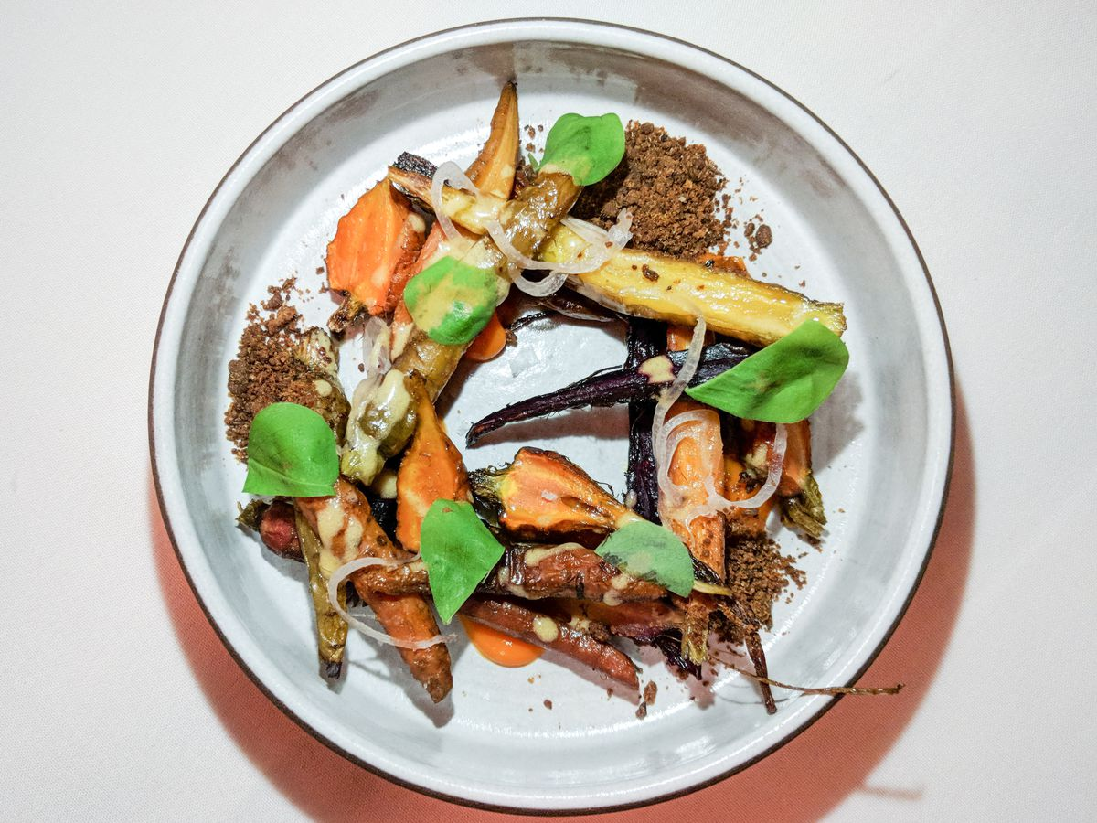 Overhead view of carrots and greens delicately plated