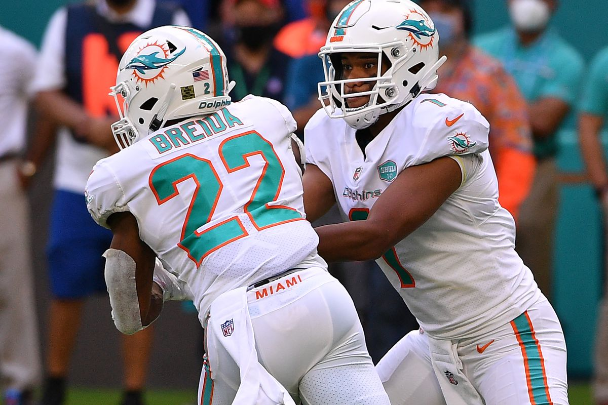 Tua Tagovailoa #1 hands the ball to Matt Breida #22 of the Miami Dolphins in the second quarter against the Los Angeles Rams at Hard Rock Stadium on November 01, 2020 in Miami Gardens, Florida.