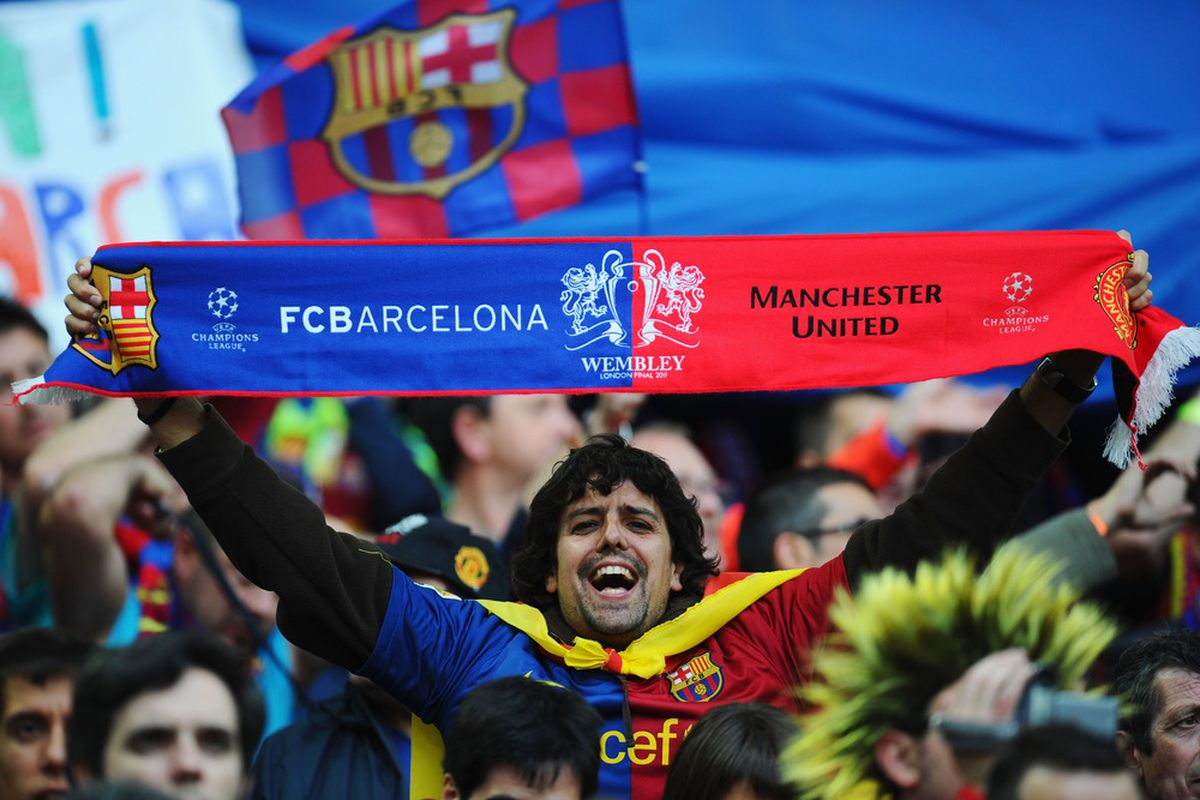 LONDON, ENGLAND - MAY 28:  A Barcelona fan enjoys the atmosphere ahead of the UEFA Champions League final between FC Barcelona and Manchester United FC at Wembley Stadium on May 28, 2011 in London, England.  (Photo by Clive Mason/Getty Images)