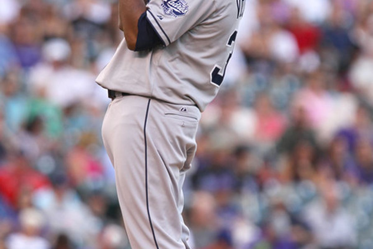 June 30, 2012; Denver, CO USA; San Diego Padres starting pitcher Edinson Volquez stretches while preparing to face a Colorado Rockies batter at Coors Field. Mandatory Credit: Andrew Carpenean-US PRESSWIRE