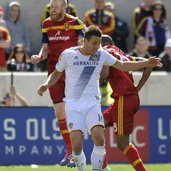 Real Salt Lake defender Nat Borchers (6) heads the ball over Los Angeles Galaxy forward Rob Friend (16) during a game at Rio Tinto Stadium on Saturday, March 22, 2014.