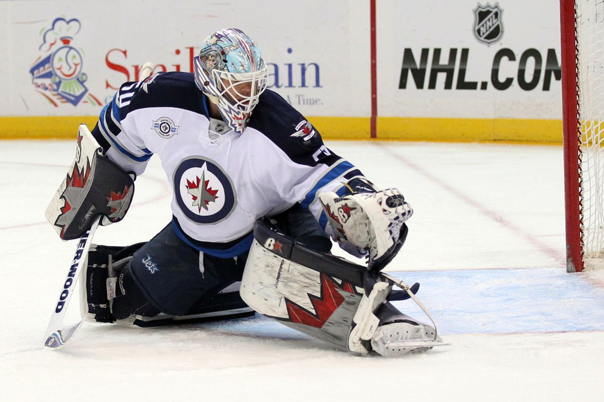 Apr 5, 2012; Uniondale, NY, USA;  Winnipeg Jets goalie Chris Mason (50) makes a glove save during the first period against the New York Islanders at Nassau Veterans Memorial Coliseum.  Mandatory Credit: Anthony Gruppuso-US PRESSWIRE