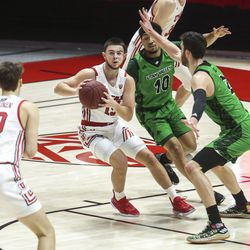 Utah Utes guard Rylan Jones (15) looks to pass as UVU Wolverines guard Jaden McClanahan (10) and UVU forward Evan Cole (2) block his path during a game at the Huntsman Center in Salt Lake City on Tuesday, Dec. 15, 2020.