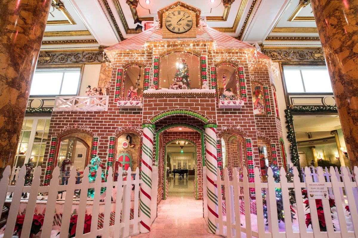 Facade of two-story gingerbread house.
