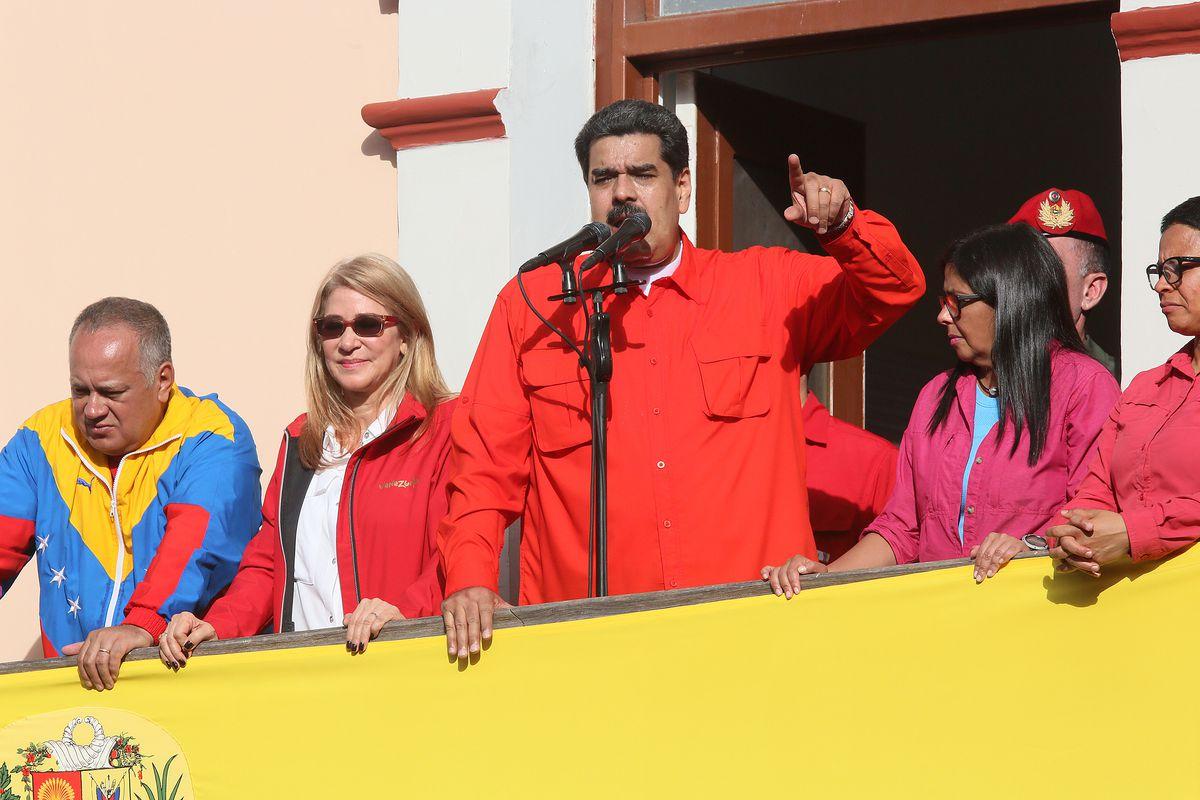 President of Venezuela Nicolás Maduro waves a national flagon January 23, 2019 in Caracas, Venezuela. He has just emboldened his standoff against Juan Guaidó.