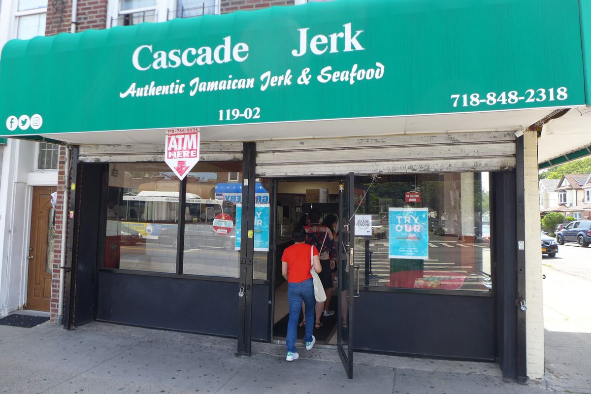 Big picture windows give Cascade Jerk a view of its South Jamaica neighborhood.