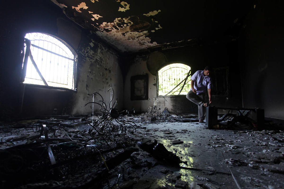 A Libyan man investigates the inside of the U.S. Consulate, after an attack that killed four Americans, including Ambassador Chris Stevens on the night of Tuesday, Sept. 11, 2012, in Benghazi, Libya, Thursday, Sept. 13, 2012.