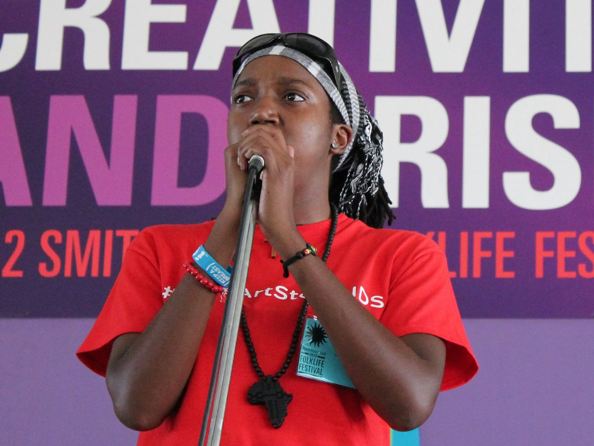 Mary Bowman, spoken word artist from Suitland, Maryland, performs at the 46th Annual Smithsonian Folklife Festival on the National Mall.