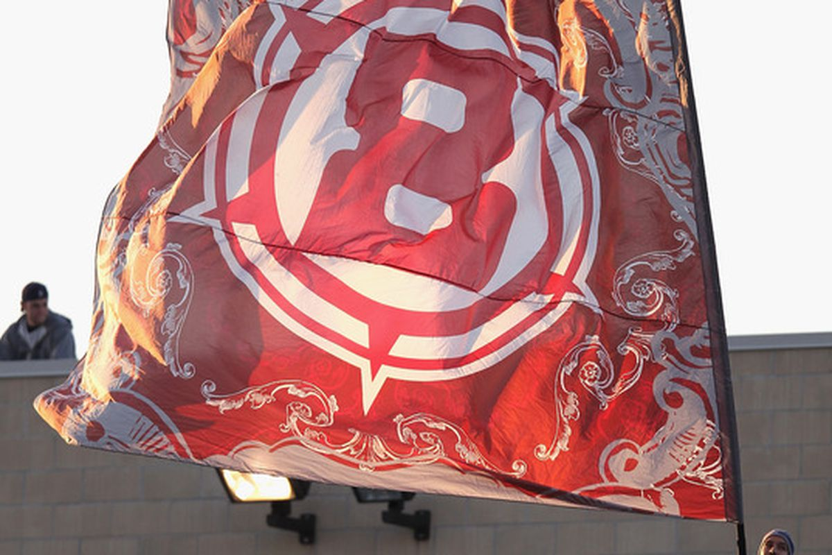 BRIDGEVIEW, IL - MAY 09: A fan of the Chicago Fire waves a flag before a match between the Fire and  Real Salt Lake at Toyota Park on May 9, 2012 in Bridgeview, Illinois. The Fire and Real Salt Lake tied 0-0. (Photo by Jonathan Daniel/Getty Images)