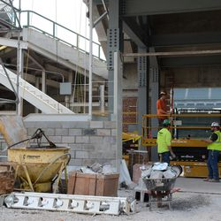 5:10 p.m. Exterior brick wall going up, around the new right field staircase still being constructed -