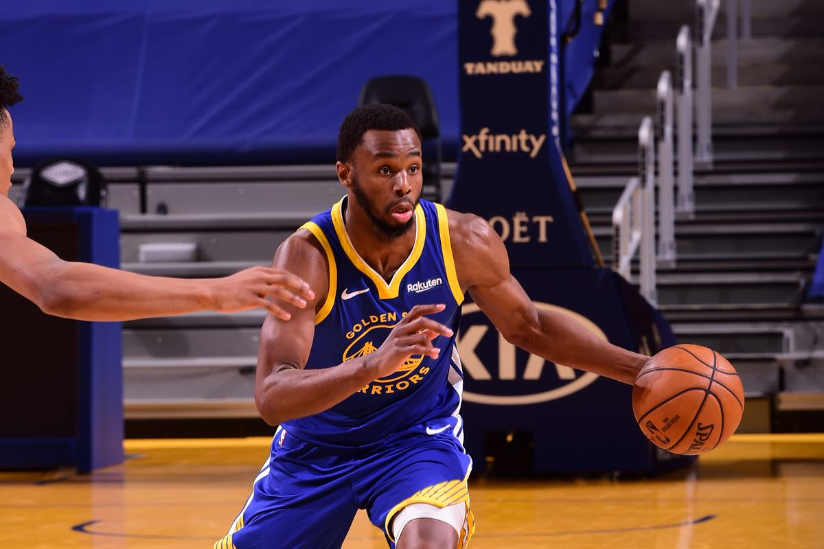 Andrew Wiggins #22 of the Golden State Warriors drives to the basket during the game against the Cleveland Cavaliers on February 15, 2021 at Chase Center in San Francisco, California.