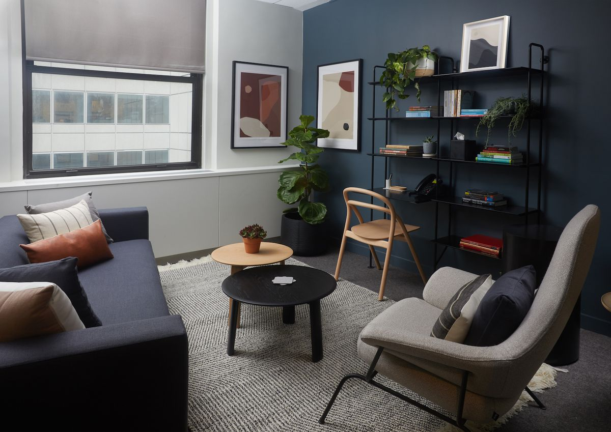 Room with couch and chair and blue painted wall