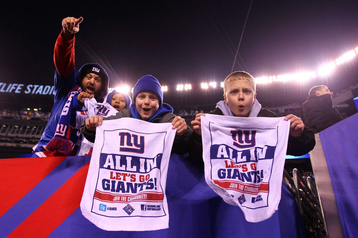 EAST RUTHERFORD, NJ - JANUARY 01:  Fans celebrate after the New York Giants defeated the Dallas Cowboys at MetLife Stadium on January 1, 2012 in East Rutherford, New Jersey.  (Photo by Al Bello/Getty Images)
