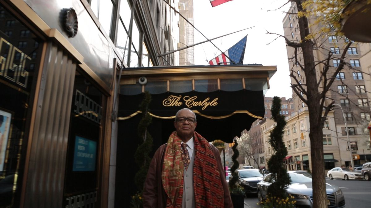 Longtime concierge Dwight Osley stands in front of the venerable Carlyle hotel in New York.   GOOD DEED ENTERTAINMENT